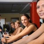 A group of women in an exercise bike class.