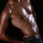 A shirtless man flexing his upper body.
