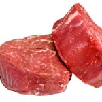 Two beef fillet steaks on a white background.
