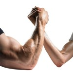An arm wrestle between two men - one with a large arm and one with a small arm.