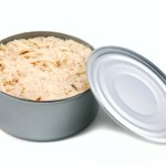 A can of tinned tuna on a white background.
