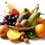 A basket containing a selection of fruit and nuts.