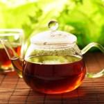A glass pot of black tea.