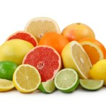 A selection of chopped and whole citrus fruits.