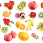 A selection of fruits, nuts and vegetables on a white background.