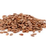 A pile of flaxseeds on a white background.