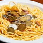 A plate of spaghetti and money.