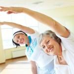 2 elderly women at an exercise class.