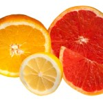 A sliced grapefruit and orange.