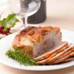 A joint of roast pork on a Christmas table.