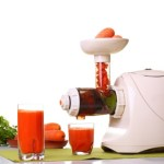 A white juicer with two glasses of juice.