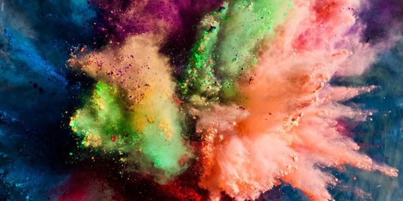 Holi powder splashing in the air.