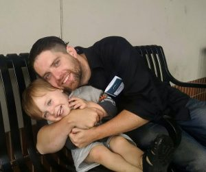 Jarrod Ean-Dixon, with the youngest of his 3 children