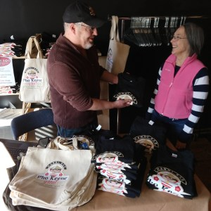 Route 101 Local Goods' Chris Rietmann talks to a happy customer.