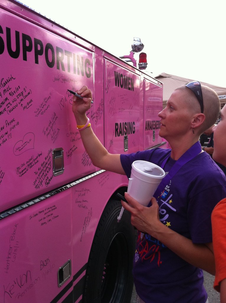 Signing pink breast cancer truck