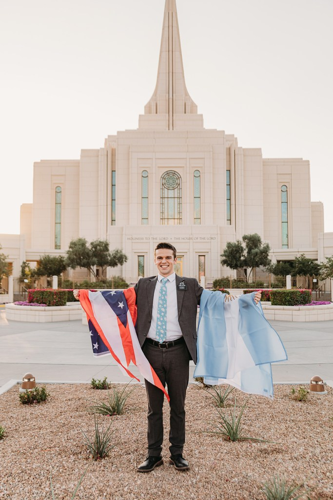 LDS missionary holding argentina flag and columbus ohio flag at gilbert az temple