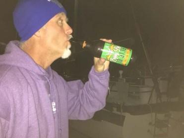 Drinking the going-away gift from Triple J (Jes, Jon, Jack)