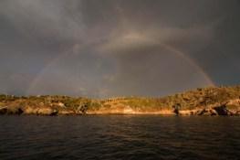 Sunrise and a rainbow over Pajarera