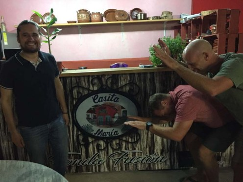 Thad and Ry bowing down to Chef Ja because they'd never had a pork chop like the one they had here