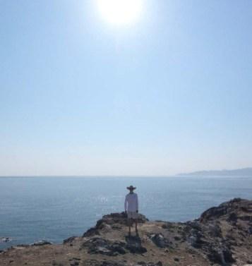 Captain Rand atop the little Pescador island