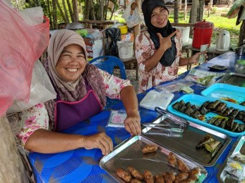 Delightful sweet street food and delightful women