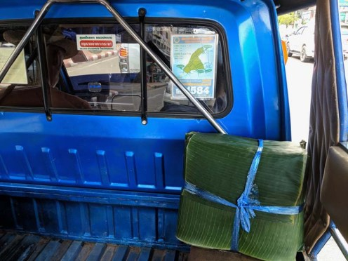 Banana leaf package in the back of a tuk-tuk for delivery