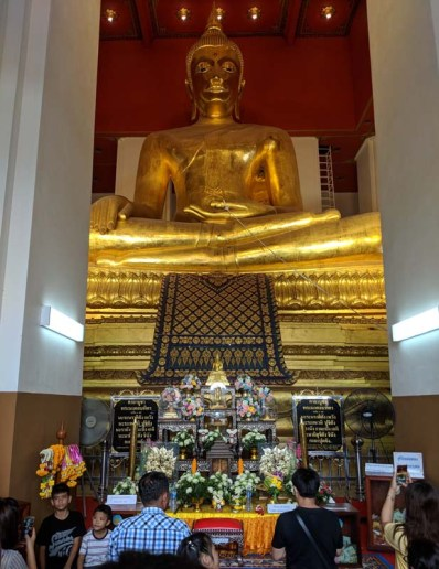 Witnessing prayer at the foot of the biggest golden Buddha we saw