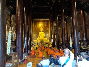 Praying monks are a tourist attraction, too