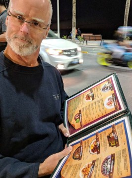 Rand reading the menu with his new readers