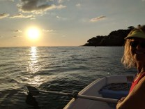Deb practicing her rowing at sunset