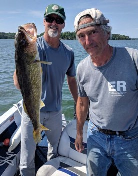 Catching a walleye for dinner with David and Eileen on Rainy Lake