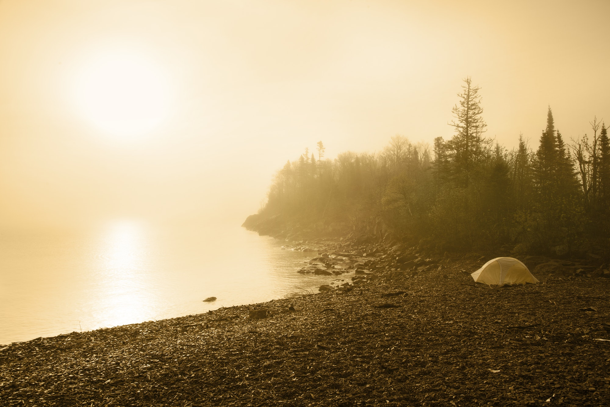Camping Tent on Beach of Lake Superior with Sun and Mist