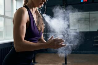 Woman Using Chalk Before Intense Training