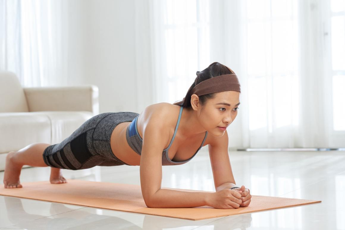 Woman Strengthening Abs