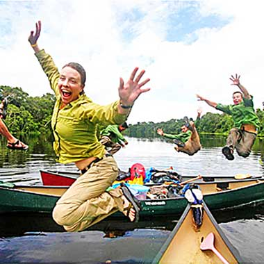 Jumping out of a canoe in the Amazon Rainforest