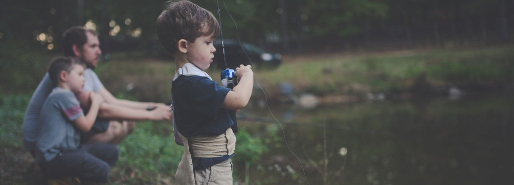 A child fishing by the pond