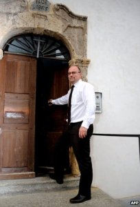 Father Pascal Vesin is seen outside his church in Megeve