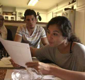 4. The Feeling of Being Watched - Assia shows FBI documents to her family_WEB