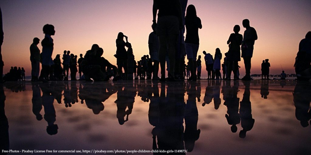 20200504 FREE Network Policy Brief image with dozen people standing at the seaside in sunset representing Women's Representation in Politics Image 01