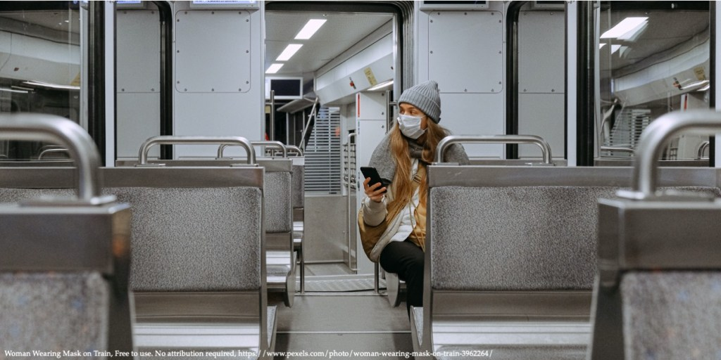 An image of a woman sitting in a public transport with a COVID-19 protection mask on the face representing the Covid-19 pandemic in Eastern Europe