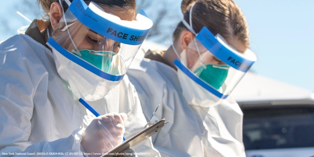 Image of two medical workers with face shields representing COVID-19 procurement