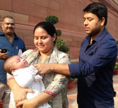 Misa Bharti with her baby son and husband at the Indian Parliament in 2016