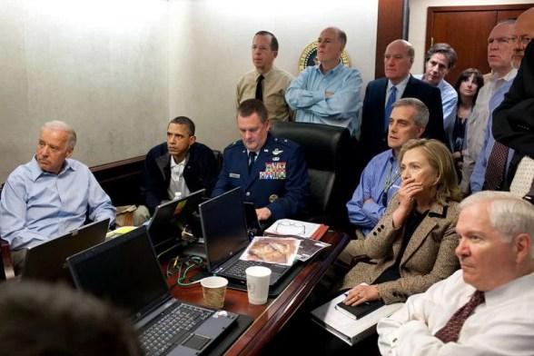 Blinken, standing in blue shirt in back of room, during the Osama Bin Laden raid