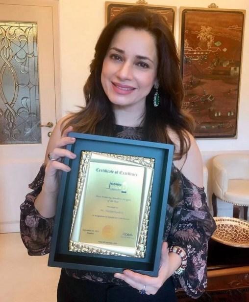 Neelam Kothari with an award