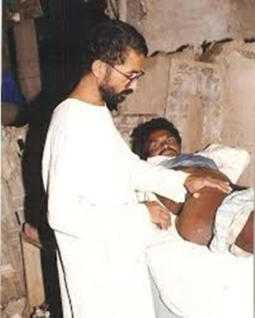 Dr. Ravindra Kolhe treating a patient in the village