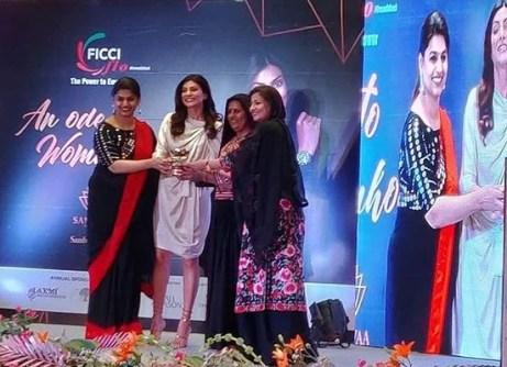 Pabiben receiving award at FICCI