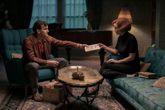 Beth Harmon (played by Anya Taylor-Joy) with Harry Beltik (played by Harry Melling) in a scene from The Queen's Gambit (2020)