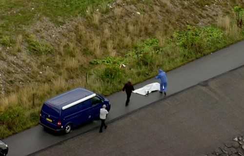 Police and coroner taking the torso of Kim Wall to the hospital