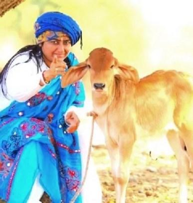 Bharti Shri Ji with a calf