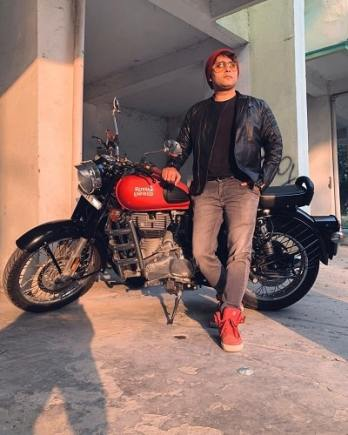 Rahul Vohra posing with his motorcycle